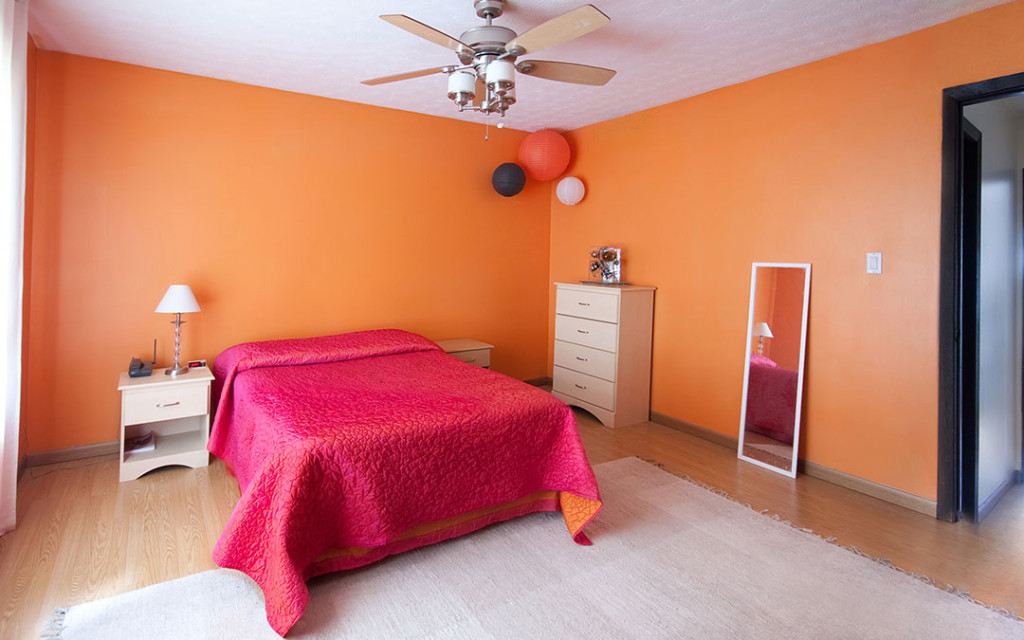 Orange-colour-bedroom-painted-with-lighter-colour-for-wall-Ceiling