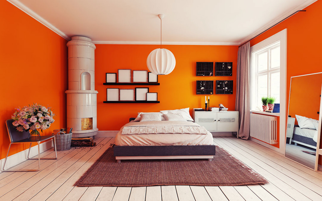 Orangw-wall-paint-colour-for-bedroom-decoarted-with-wall-frames