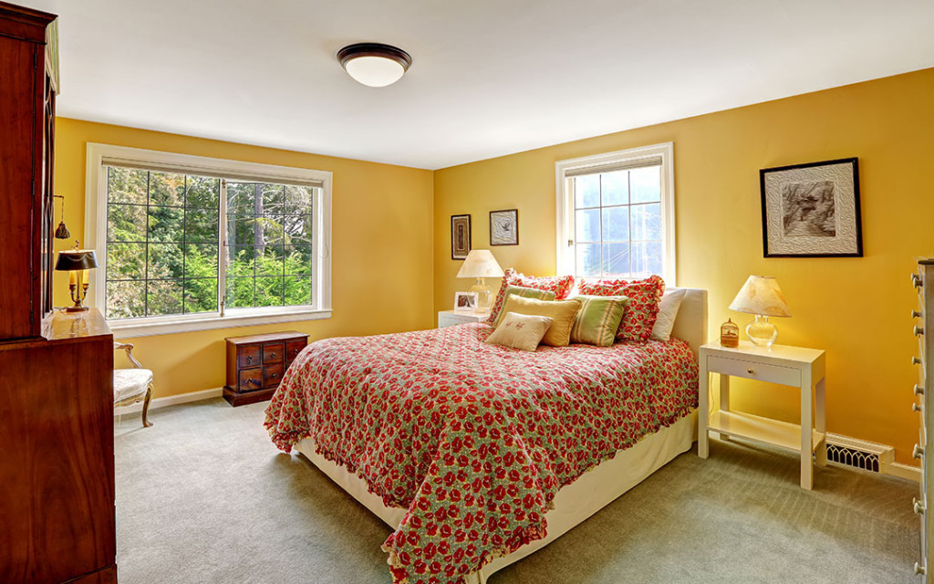 yellow-colour-bedorom-decorated-with-wall-frames