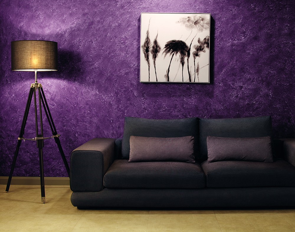 A-room-with-sofa-and-violet-colour-walls-designed-with-textures-