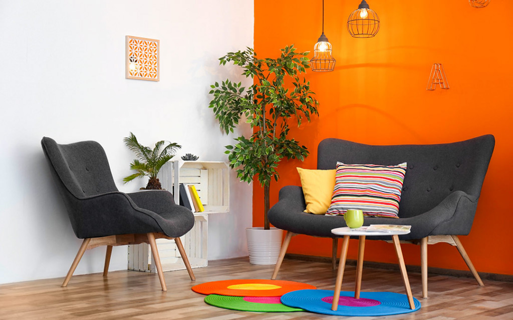 Modern-living-room-have-hanging-lamps-painted-with-orange-colour